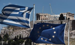 Dual identity: the Greek and European Union flags share the skyline in front of the Parthenon. Photograph: Aris Messinis/AFP/Getty Images