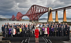 Scottish first minister Nicola Sturgeon and the new SNP MPs pose in front of the Forth rail bridge o