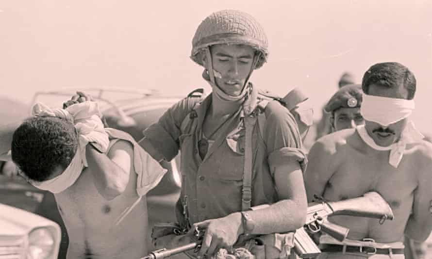 Israeli troops arrest Palestinians shortly after the six-day war of 1967.