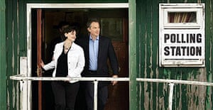 Tony and Cherie Blair leave their local polling station after voting on May 5, 2005