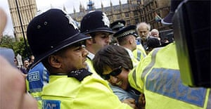 Police grapple with protesters in Parliament Square. Photograph: Ian Nicholson / PA
