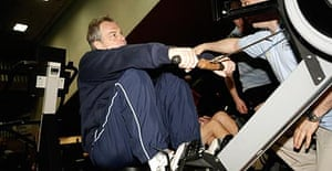 Tony Blair exercises on a rowing machine