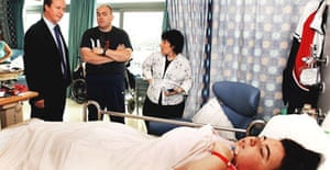 The Conservative Party leader, David Cameron, talks to Carl and Maria Boucher, the parents of Hannah, 16, from Hengoed, south Wales, in the Sky Ward of Great Ormond Street hospital, central London, on Monday October 9 2006. Photograph: John Stillwell/PA.