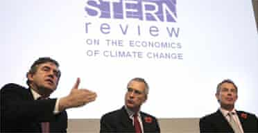 Sir Nicholas Stern is accompanied by Gordon Brown and Tony Blair during a presentation of his report on climate change at the Royal Society