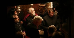 The Archbishop of Canterbury, Rowan Williams, top centre, prays with others in the grotto where Christians traditionally believe Jesus Christ was born, at the Church of the Nativity, in the West Bank town of Bethlehem on December 21 2006. Photograph: Nasser Shiyoukhi/AP.