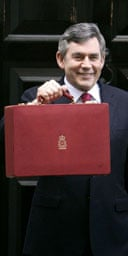 Gordon Brown leaves 11 Downing Street with his red box to deliver his 11th budget on March 21 2007. Photograph: Andrew Parsons/PA.