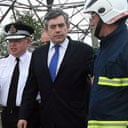 Gordon Brown looks at the small amount of flood water that had still to be pumped from the Walham electricity station in Gloucester on July 25 2007. Photograph: Matt Cardy/Getty Images.