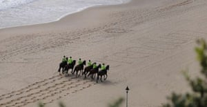 Police horses walk over the slogan 'I want a referendum', written in the sand at the Labour conference in Bournemouth on September 25 2007. Photograph: Dan Chung.