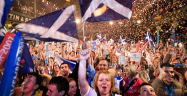 Glaswegians celebrate their city's winning the 2014 Commonweath Games on November 9 2007. Photograph: Murdo Macleod. ONLY TO BE USED WITH SCOTLAND AWAKES BY JOHN HARRIS, NOVEMBER 30 2007