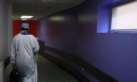A surgeon makes his way home after working in theatre at the Queen Elizabeth hospital in Birmingham on June 14 2006. Photograph: Christopher Furlong/Getty Images