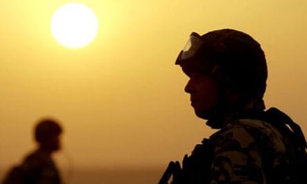 A British soldier stands guard in a location south of Basra, Iraq, in April 2003. Photograph: Dan Chung