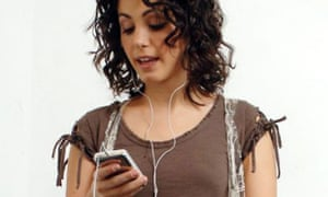 Katie Melua listening to her iPod. Photograph: Linda Nylind