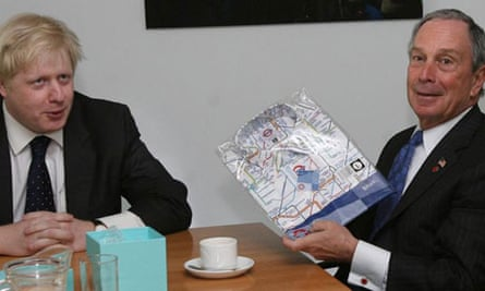 Boris Johnson gives his New York counterpart, Michael Bloomberg, a London Underground shirt at City Hall in London on May 9 2008. Photograph: Lewis Whyld/PA Wire