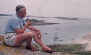 Harold Wilson, the prime minister, sitting quietly smoking his pipe on a rock, during a holiday to the Scilly Isles in 1965. Photograph: Peter King/Fox Photos/Getty Images