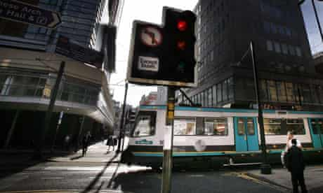 A Metrolink tram moves through the centre of Manchester. Photograph: Christopher Thomond