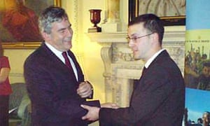 Plane Stupid Activist Dan Glass, being greeted by Gordon Brown, as he tries to glue himself to the prime minister in Downing Street