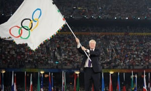Boris Johnson waves the Olympic flag in the Bird's Nest stadium in Beijing on August 24 2008. Photograph: Jewel Samad/AFP/Getty Images