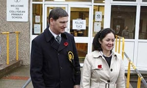 Scottish National party candidate Peter Grant and his wife Fiona vote in the Glenrothes byelection