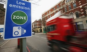 A lorry passes a low emission zone sign in London. Photograph: Daniel Berehulak/Getty Images