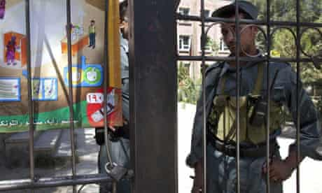 An Afghan policeman guards a polling station in Kabul