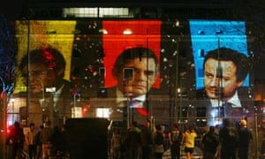 The three leaders projected onto the studios where Sky News filmed the second leaders' debate