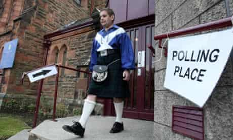 A voter leaves Westpark church in Denny, Central Scotland, after voting in the Falkirk constituency