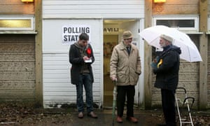 A voter leaves a polling station in the Oldham East and Saddleworth byelection