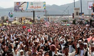 Anti-government protesters chant slogans during a rally in Sana'a