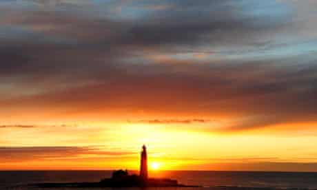 The sun rises over St Mary's Lighthouse at Whitley Bay, North Tyneside