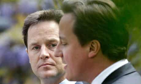 Cameron and Clegg conduct their first joint news conference in the garden of 10 Downing Street