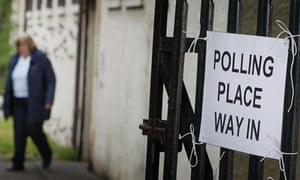 A voter leaves a polling place after casting a vote in the Inverclyde byelection