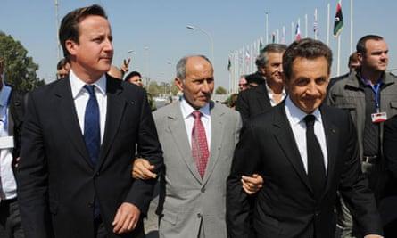 David Cameron and Nicolas Sarkozy flank the NTC chairman, Mustafa Abdel Jalil, in Tripoli, Libya