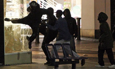 Rioters to kick in the window of a shop