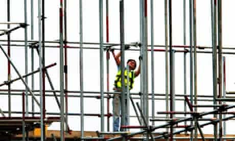 A scaffolder at work on a building site