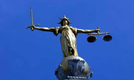 The statue of justice, clutching sword and scales