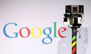 The camera of a Google Street View car next to the Google logo