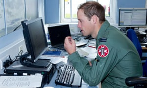 Prince William sits at a computer