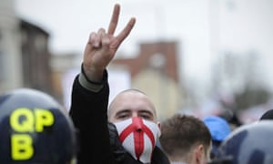 A member of the English Defence League gestures during a rally in Luton