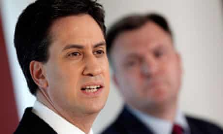 Ed Balls looks at as Ed Miliband discusses economic policy