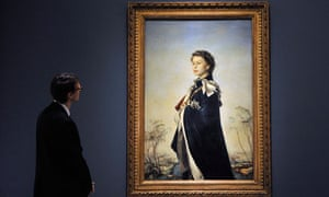 A gallery worker looks over Italian artist Pietro Annigoni's portrait of the Queen