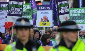 Demonstrators march with trade union placards last November