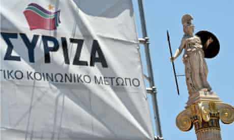 A statue of Athena, patron of Athens, is seen near a Syriza party election campaign kiosk