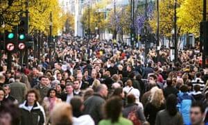 Crowds walking along Oxford Street, central London