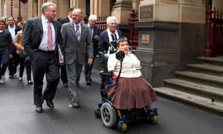 Lynette Rowe (C) with her legal team and supporters out the supreme court in Melbourne