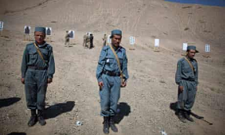 Afghan police officers train at a firing range in the central province of Bamiyan