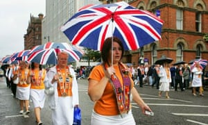 Women belonging to one of the many Orange Order lodges marching through Belfast