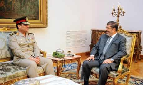 Mohamed Morsi (R) and the newly appointed Egyptian defence minister, Abdel-Fatah el-Sissi