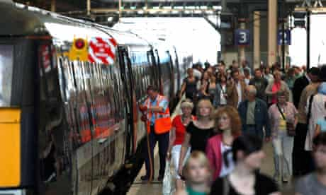 Passengers alight from a train at Kings Cross