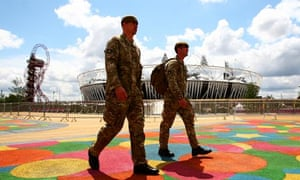 Soldiers walk past the Olympic stadium
