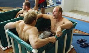 Lawrence Dallaglio (right) and Matt Dawson of England take a dip in a ice cold bath